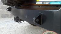 В бампер установлены буксировочные проушины, парктроник и адаптация под фаркоп.